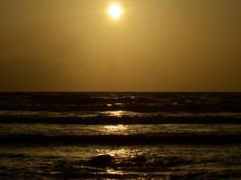 Sun bathed vast ocean